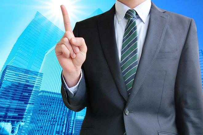 ビジネスの秘訣を示す男性